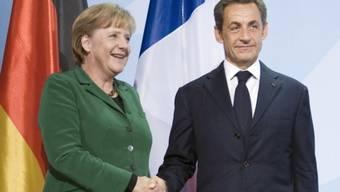 Angela Merkel und Nicolas Sarkozy stimmen sich noch vor dem Euro-Gipfeltreffen ab (Archiv)