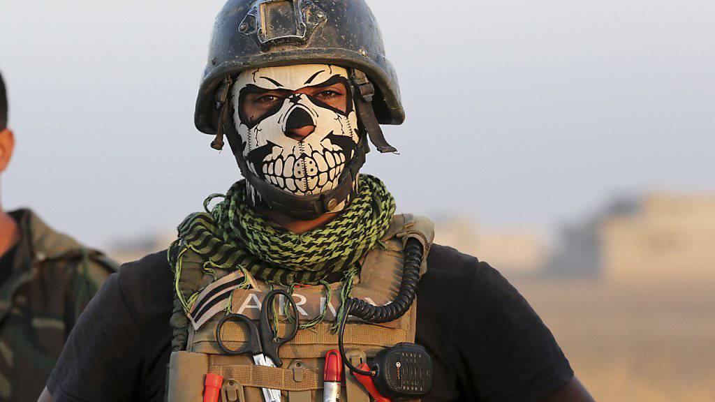 Wer hat keine Angst vor mir? - Mitglied der irakischen Antiterror-Eliteeinheit, die am Sturm auf Mossul beteiligt ist.