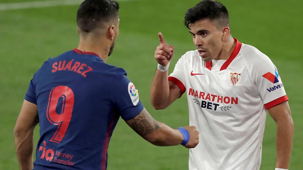 Sevilla-Verteidiger Marcos Acuña ermahnt Atléticos Luis Suarez - und trifft später zum Sieg
