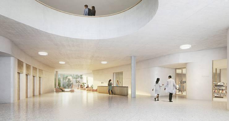 Die Eingangshalle erstreckt sich wie im Klinikum 1, aber in intimerem Massstab, von der Strasse zum Spitalgarten. Von dort aus erreicht man direkt alle Abteilungen im Sockel und im Turm.