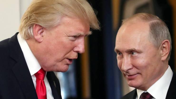 US-Präsident Donald Trump und Russlands Präsident Waldimir Putin an einem Treffen anfangs November. (Archivbild)
