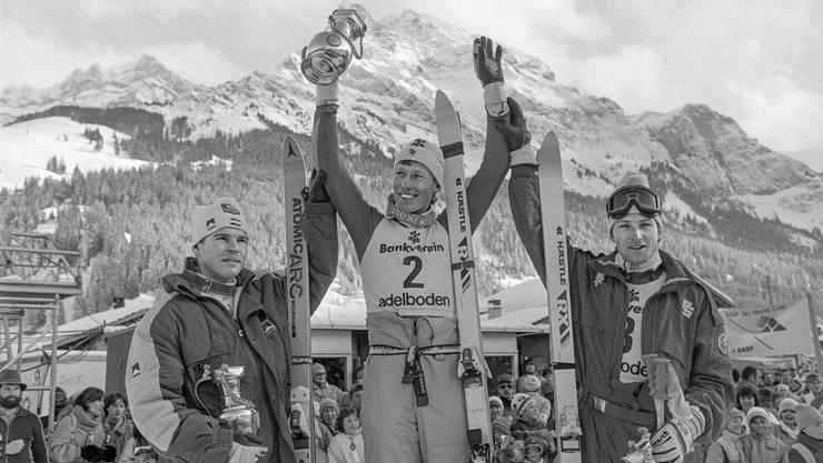 Pirmin Zurbriggen (M.) gewinnt den Riesenslalom bei den Internationalen Adelbodner Skitagen im Jahre 1987 vor Marc Girardelli (l.) und Hubert Strolz