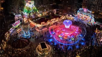 Basler Herbstmesse bei Nacht, lange Belichtungszeit, Licht und Tempo