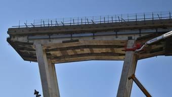Inzwischen abgerissener Überrest der am 14. August 2018 eingestürzten Morandi-Brücke in Genua. Am Mittwoch gedachte die Stadt der Todesopfer des Brückeneinsturzes.