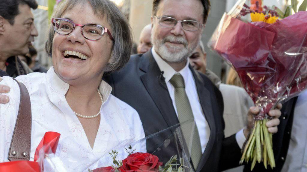 Die strahlenden Sieger: Liliane Maury Pasquier und Robert Cramer. (KEYSTONE/Martial Trezzini)
