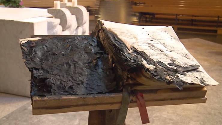 Das Evangelien-Buch wurde Opfer des Feuers. (Archiv)