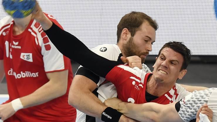Andy Schmid (rechts) kann heute mit den Rhein Neckar Löwen wieder Meister werden r