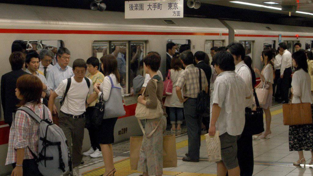 Mit Heimarbeit soll der Verkehr während der Olympischen Sommerspielen in Japan 2020 entlastet werden. Dafür üben die Japaner bereits drei Jahre vorher. (Symbolbild)
