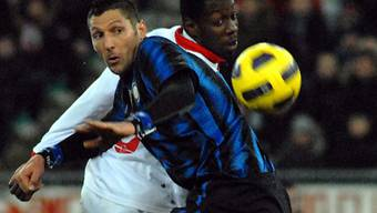 Inters Marco Materazzi (l.) und Stefano Okaka
