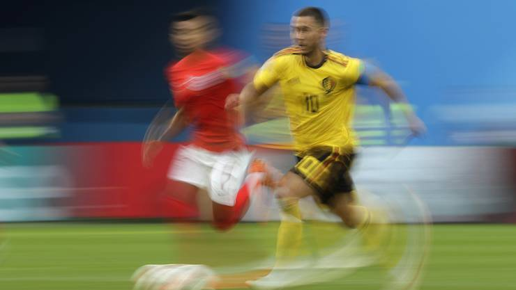 Belgium's Eden Hazard, right, is challenged by England's Jesse Lingard as he runs with the ball during the third place match between England and Belgium at the 2018 soccer World Cup in the St. Petersburg Stadium in St. Petersburg, Russia, Saturday, July 14, 2018. (AP Photo/Petr David Josek)