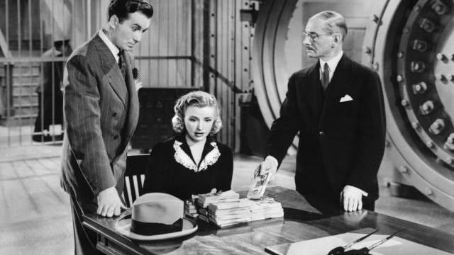 Für Bargeld der Banksafe: Szene aus dem Film «Million Dollar Baby» («Der Geldregen») mit Jeffrey Lynn, Priscilla Lane und Charles Halton (v. l.).  Foto: Cinetext