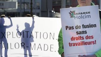 Ausbau der Arbeitnehmerrechte: Proteste vor der Holcim-GV
