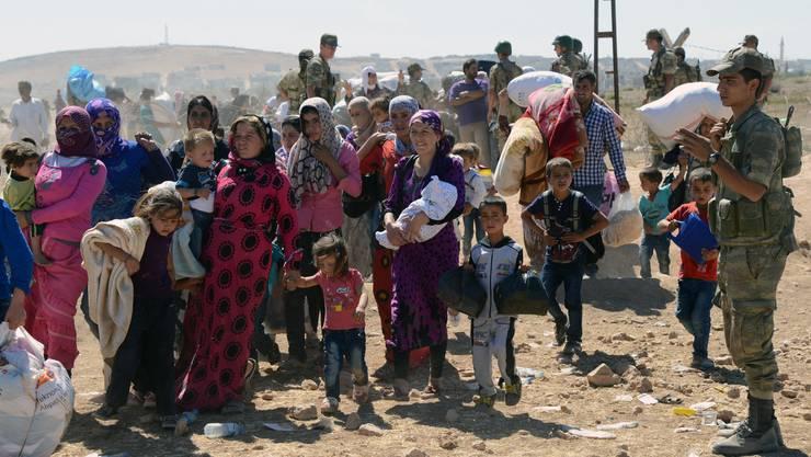 Zehntausende syrische Kurden flüchteten vor dem IS.