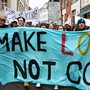 "People demonstrate during a ""Climate strike"" demonstration with a banner reading ""Thank's to the oil lobby, striking becomes a hobby"" to protest a lack of climate awareness, in Basel, Switzerland, Friday, March 1, 2019. (KEYSTONE/Georgios Kefalas)"
