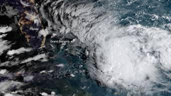 """Ein neuer Tropensturm zieht am verwüsteten Norden der bahamas vorbei. """"Humberto"""" bringe heftige Regenfälle und Sturmböen in die Region um die Abaco-Inseln, meldete der US-Wetterdienst am Samstag. (Bild vom 13. September)"""