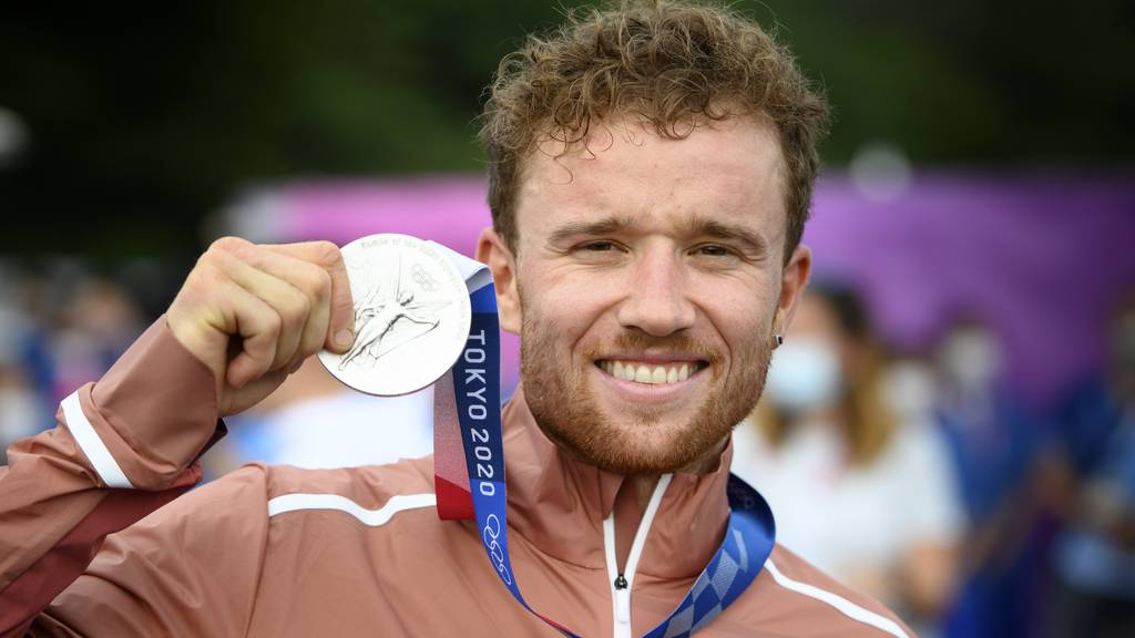Silver medalist Mathias Flueckiger of Switzerland reacts during the medal ceremony for the Men's Cross-Country event of the Mountain Biking events of the Tokyo 2020 Olympic Games at the Izu Mountain Bike Course in Ono, Shizuoka, Japan, 26 July 2021