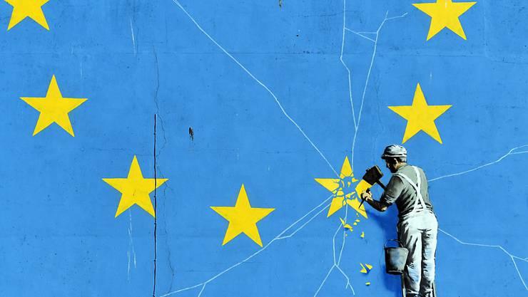 Die EU-Staaten haben der Ratifizierung des Austrittsabkommens mit Grossbritannien zugestimmt. Im Bild das Wandgemälde des britischen Graffiti-Künstlers Banksy zum Brexit in der südenglischen Hafenstadt Dover. (Archivbild)