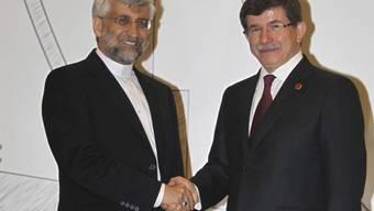 Der iranische Unterhändler Dschalil mit dem türkischen Aussenminister Davotuglu