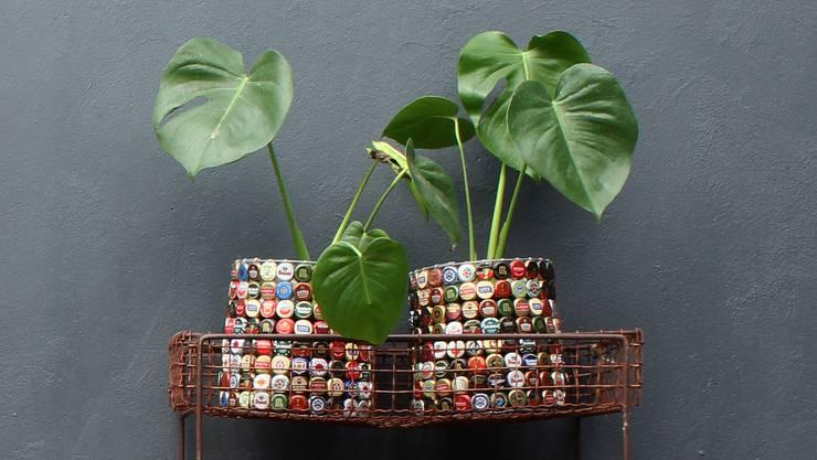 Blumentöpfe mit Bierdeckeln: Das Designstudio «Recreate» in Kapstadt arbeitet nur mit gebrauchten Gegenständen.
