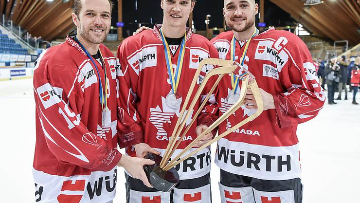 Andrew Ebbett, Mason Raymond und Maxim Noreau vom SC Bern (v.l.n.r.) sowie Maxim Lapierre (nicht im Bild) gewannen im Dezember mit dem Team Canada den Spengler Cup. Nun wurde das Quartett auch für das Olympia-Turnier in Südkorea aufgeboten