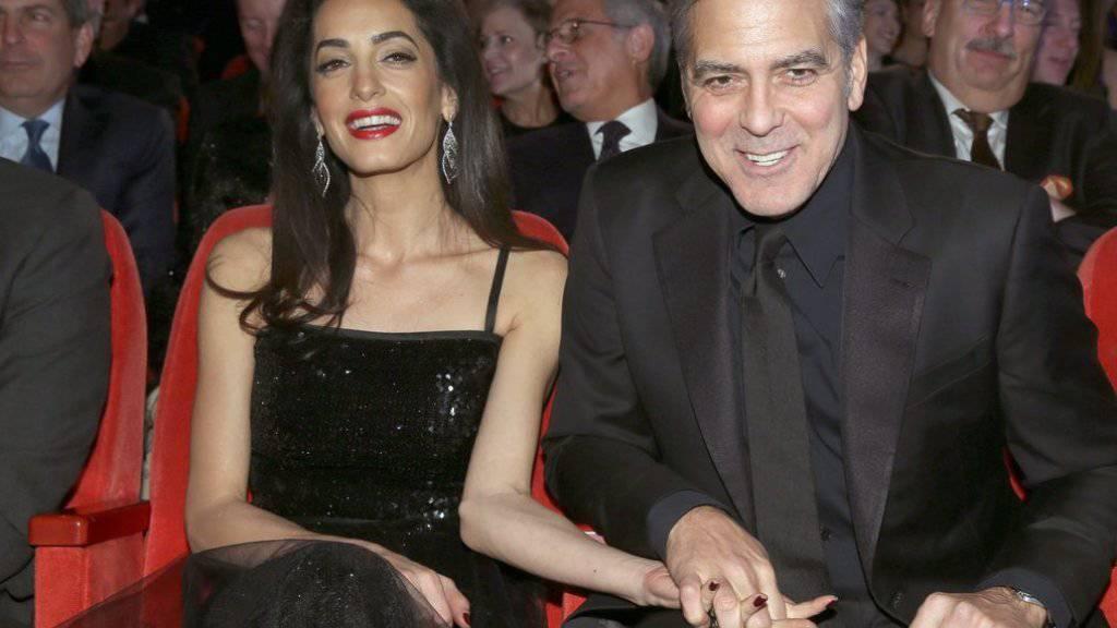 Roter Teppich, Besuch bei der deutschen Bundeskanzlerin, Filmvorstellung an der Berlinale: Zusammen kriegen Amal und George Clooney einfach alles gebacken (Archiv).