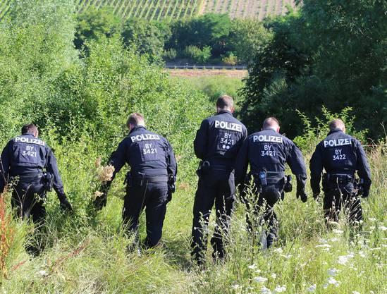 Ermittler im Einsatz nach Axt-Attack in Zug bei Würzburg