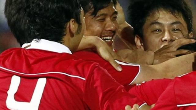 Chinas Fussballer jubeln
