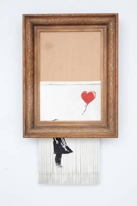 """Banksy schredderte sein Bild """"Girl with Balloon""""."""
