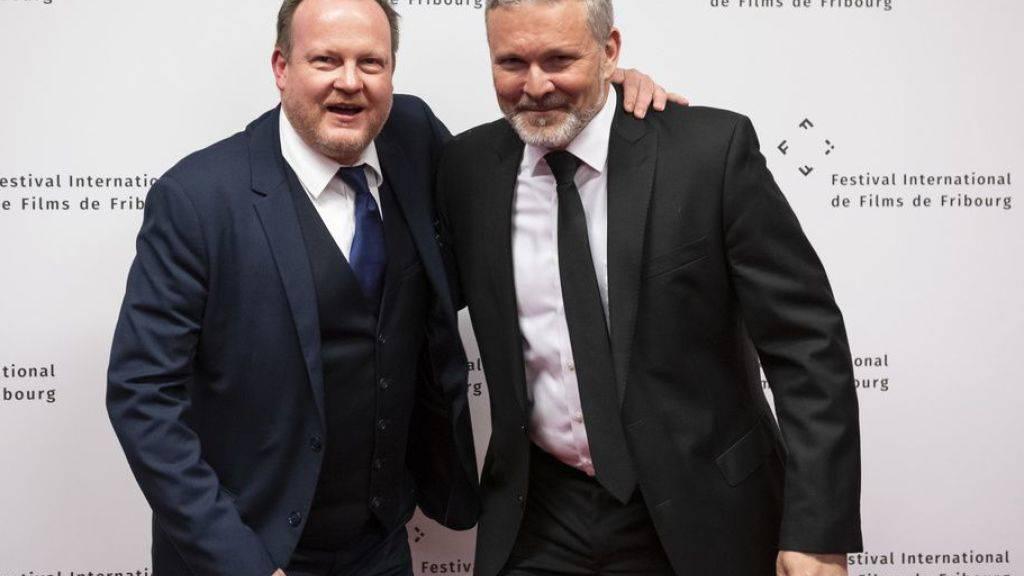 Der künstlerische Direktor Thierry Jobin (links) zusammen mit FIFF-Präsident Mathieu Fleury bei der Eröffnung des 33. Internationalen Filmfestivals Freiburg.