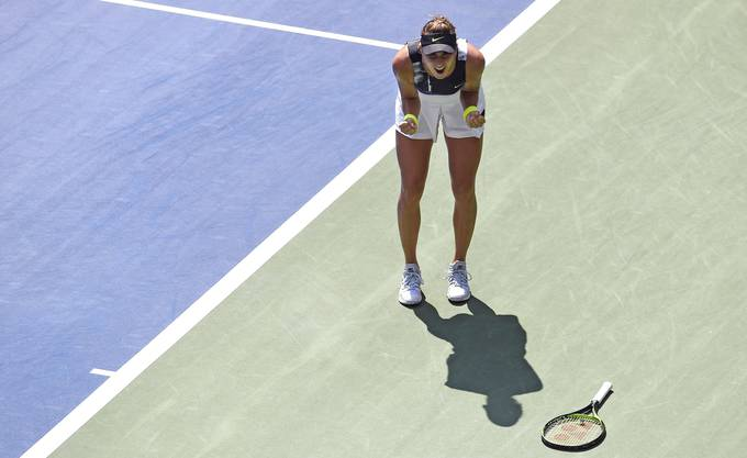 Belinda Bencic, of Switzerland, celebrates after defeating Donna Vekic, of Croatia, during the quarterfinals of the U.S. Open tennis championships Wednesday, Sept. 4, 2019, in New York. (AP Photo/Sarah Stier)