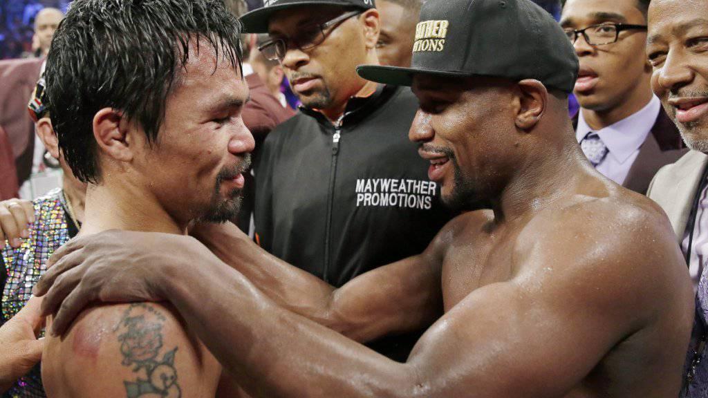 Wollen es im Boxring offenbar nochmals wissen: Floyd Mayweather (rechts) und Manny Pacquiao (links)