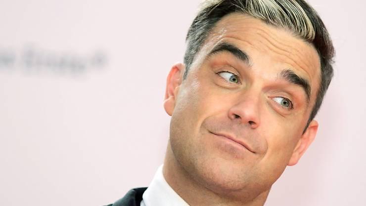 """Weil er so ein zärtlicher Vater ist hat Robbie Williams für seinen zweijährigen Sohn Charlie den Song """"Motherfucker"""" gechrieben. (Archivbild)"""