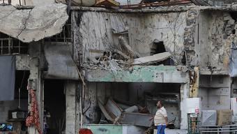 Die Menschen in Syrien sollen ihre im Krieg zerstörten Häuser wieder reparieren und aufbauen können. Caritas Schweizer verlangt vom Bund, bei der Ausbildung von Baufachleuten zu helfen. (Themenbild)