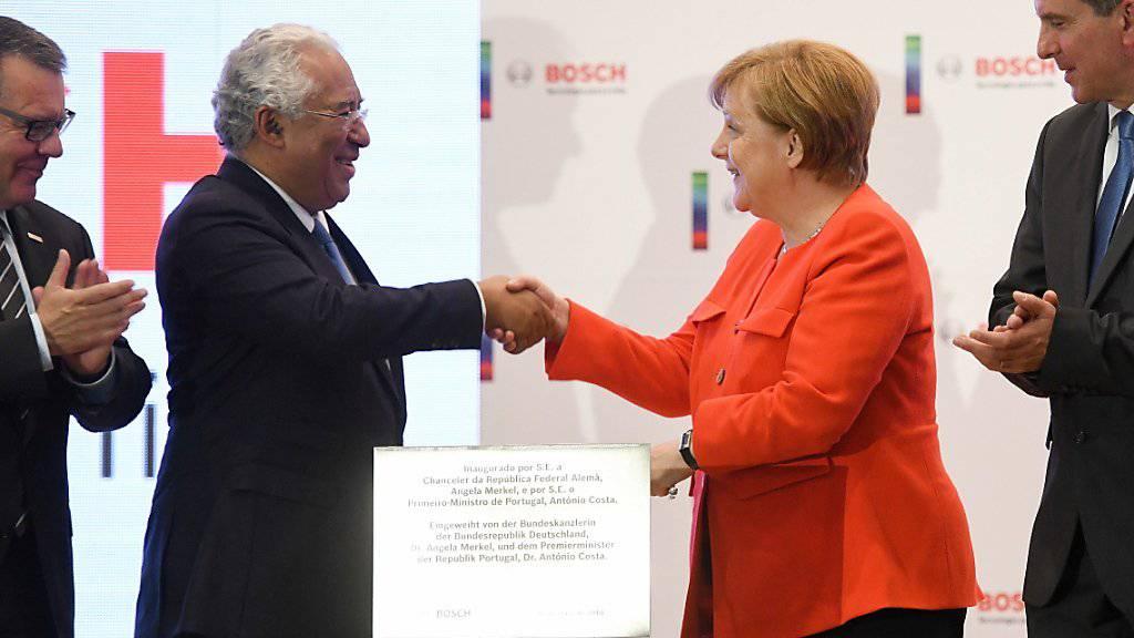 Der portugiesische Ministerpräsident Costa und die deutsche Kanzlerin Merkel bei der Einweihung eines Entwicklungs- und Technologiezentrums des Konzerns Bosch.