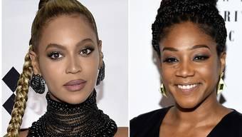 """US-Sängerin Beyoncé Knowles (links) soll im Dezember ins Gesicht gebissen worden sein, erzählte """"Girls Trip""""-Schauspielerin Tiffany Haddish (rechts)."""