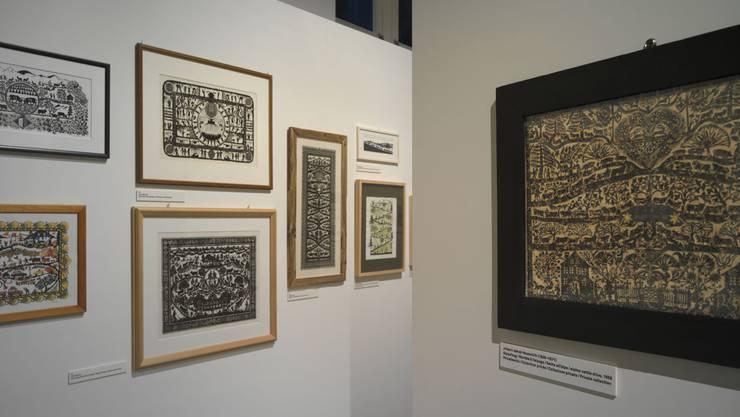 Ausstellungsteil Alpaufzug mit historischem Scherenschnitt von Johann Jakob Hauswirth
