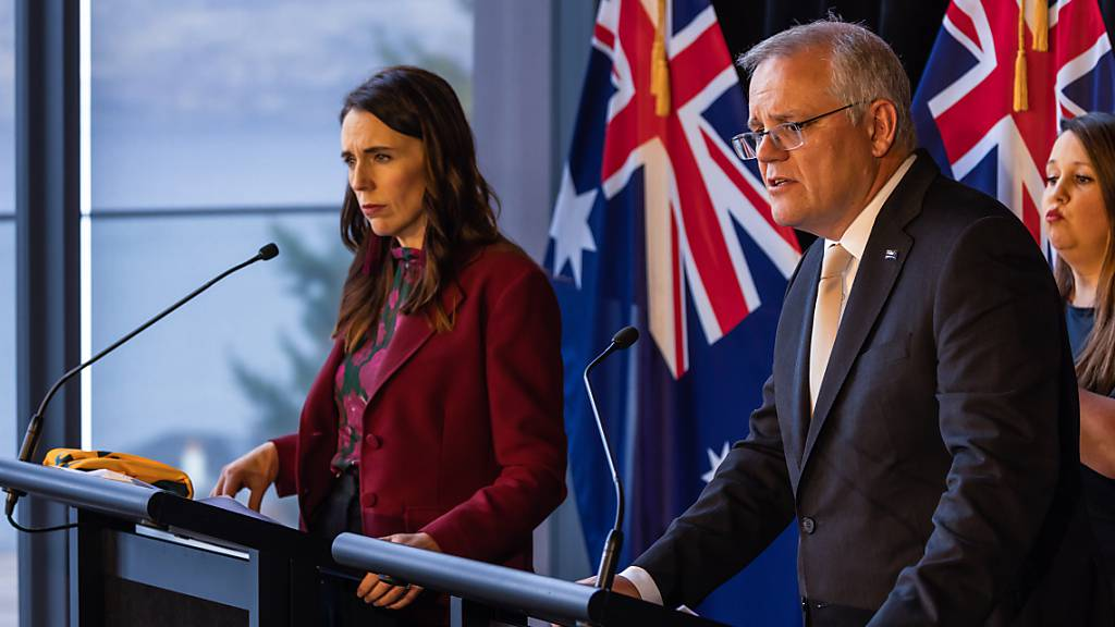 New Zealand Prime Minister Jacinda Ardern and Australian Prime Minister Scott Morrison speak during a joint press conference held at The Nest in Queenstown, New Zealand, Monday, May 31, 2021. Australian Prime Minister Scott Morrison is on a two-day visit to New Zealand to attend the annual Australia-New Zealand Leaders' Meeting. (AAP  Image/Peter Meecham) NO ARCHIVING