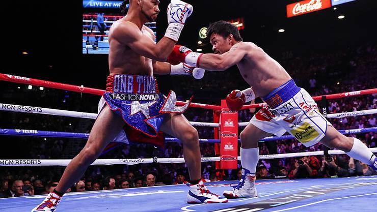 Auch mit 40 noch beweglich und schlagkräftig: Manny Pacquiao (re.) gewinnt gegen den Titelverteidiger Keith Thurman den WM-Titel der WBA im Weltergewicht
