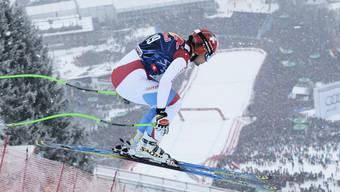 Patrick Küng stürzte sich letztes Jahr die Streif hinunter. Im Ziel erwarten ihn zehntausende begeisterte Skifans. Ein einzigartiges Bild.