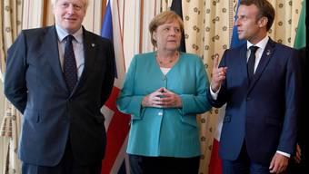 Der französische Präsident Macron (r) hat das Gipfeltreffen der grossen Industrienationen (G7) in Biarritz eröffnet.