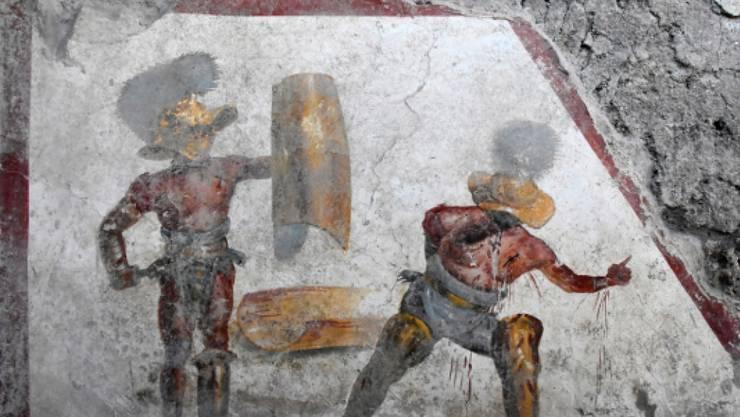 Das neu entdeckte Fresko in der Römerstadt Pompeji zeigt zwei Gladiatoren im Kampf - mit detaillierter Darstellung der Wunden.