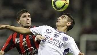 Nach der späten Niederlage gegen Rennes in arger Rücklage: Toulouse mit  Wissam Ben Yedder (rechts, Archivbild)