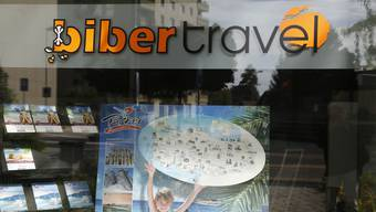 Schaufenster des Reisebüros Biber Travel im Juli 2013.