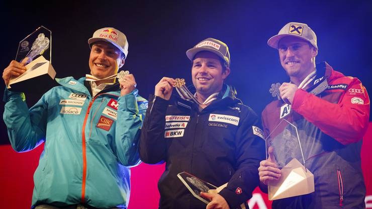 Feuz mit Silbermedaillengewinner Erik Guay (l.) und Max Franz, der Dritter wurde.