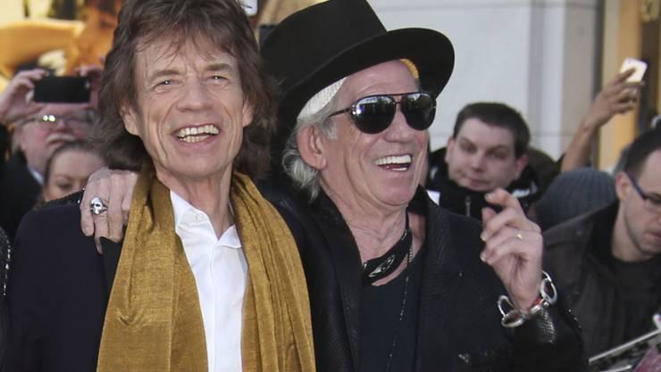 """""""Zeit für einen Schnitt"""": Rolling Stones-Gitarrist Keith Richards (Links) über Sänger Mick Jagger. (Archivbild)"""