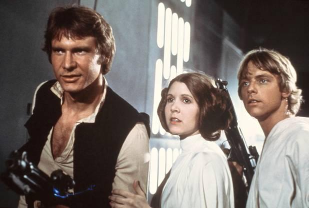 Die Schauspieler Harrison Ford, Carrie Fisher und Mark Hamill im Film «Star Wars» 1977.