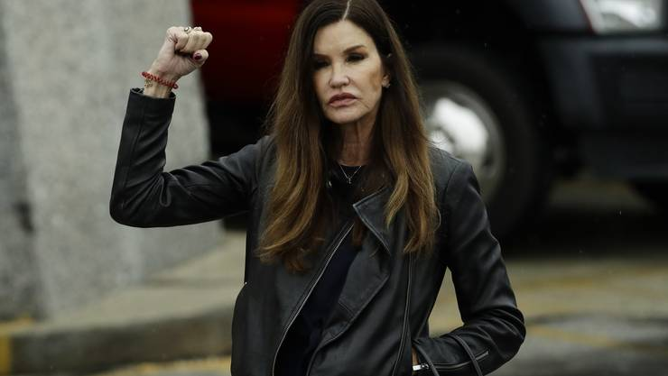 Former model Janice Dickinson gestures outside the Montgomery County Courthouse during Bill Cosby's sentencing hearing, Tuesday, Sept. 25, 2018, in Norristown, Pa. (AP Photo/Matt Slocum)