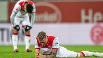 Die Spieler von Fortuna Düsseldorf am Boden (Archivbild)