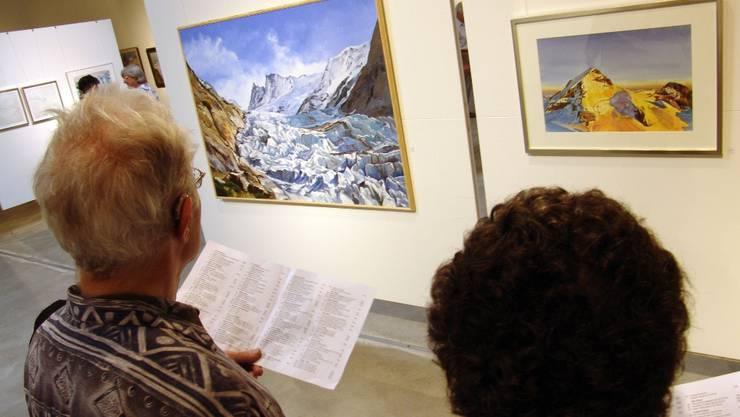 Die Bergbilder strahlen Wärme aus – den kalten Farben zum Trotz. Christian Murer