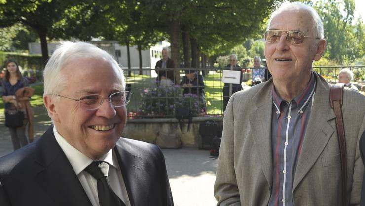 Christoph Blocher und Helmut Hubacher bei der Beerdigung von Otto Stich. (Archivbild)
